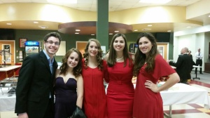 ladies in red and one lucky Joe.