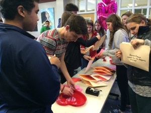the Empowerment club putting together the Healthy Relationship gifts for advisories yesterday!