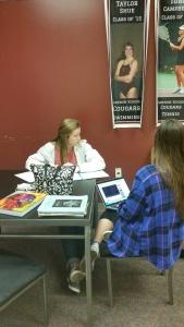 Seniors working on English project.