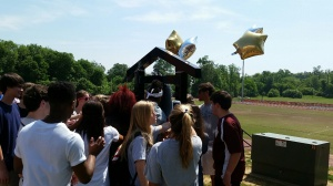 Seniors present  the Victory bell.