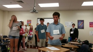 Students act out part of a novel they read,